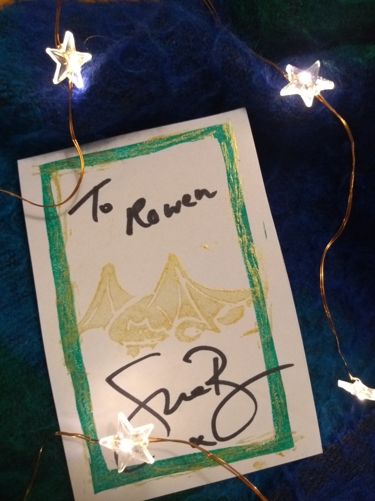 A bookplate signed To Rowen, printed with a golden dragon, green